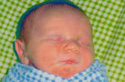 Close up of bundled, sleeping infant