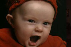 Close view of baby in red with mouth open