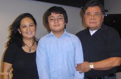 Family with boy in center flanked by his parents