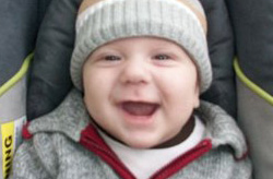 Close up of smiling baby wearing winter cap